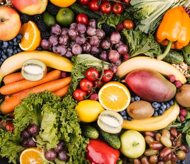 Vista dall'alto gustoso sfondo fatto con frutta Foto Gratuite