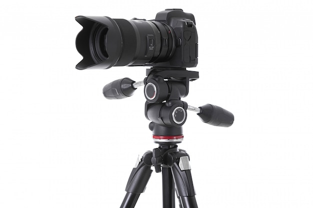 Vista laterale della macchina fotografica professionale con il grande vetro della macchina fotografica isolato Foto Premium