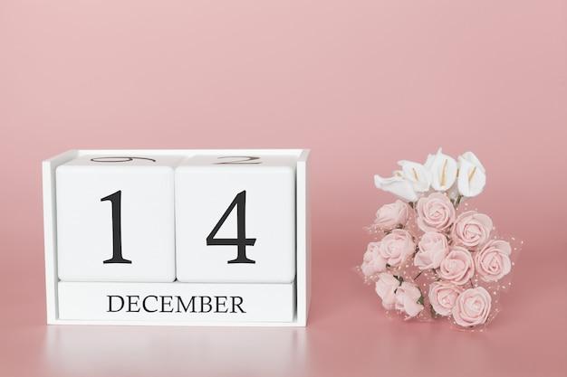 14 de dezembro. dia 14 do mês. calendar o cubo no fundo cor-de-rosa moderno, no conceito do negócio e em um evento importante. Foto Premium
