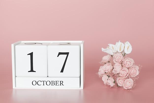17 de outubro calendário cubo no fundo rosa moderno Foto Premium