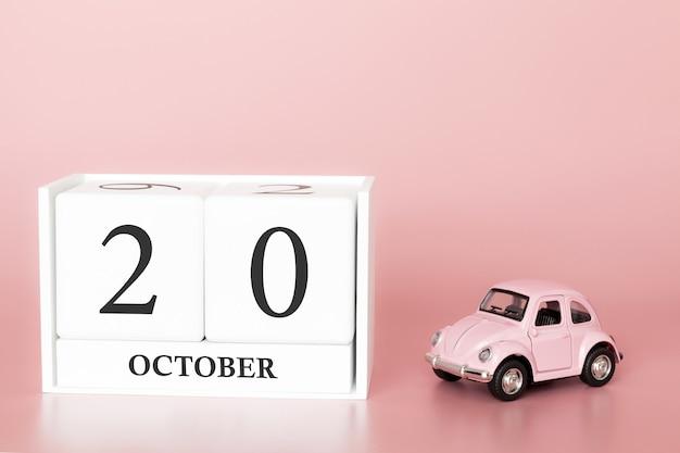 20 de outubro dia 20 do mês. cubo de calendário com carro Foto Premium