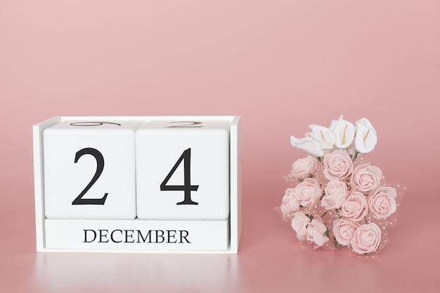 24 de dezembro. dia 24 do mês. calendar o cubo no fundo cor-de-rosa moderno, no conceito do negócio e em um evento importante. Foto Premium