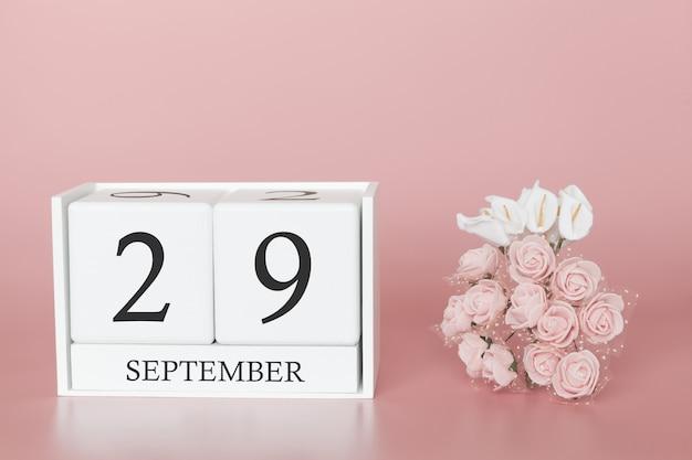 29 de setembro dia 29 do mês. calendar o cubo no fundo cor-de-rosa moderno, no conceito do negócio e em um evento importante. Foto Premium