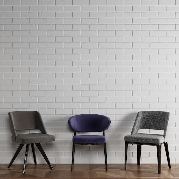 3 cadeiras diferentes em estilo moderno, em frente a parede de tijolos brancos com copyspace Foto Premium