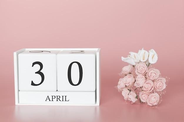 30 de abril. dia 30 do mês. cubo de calendário na rosa moderna Foto Premium