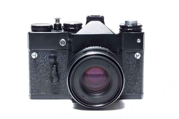 A câmera no fundo branco Foto Premium