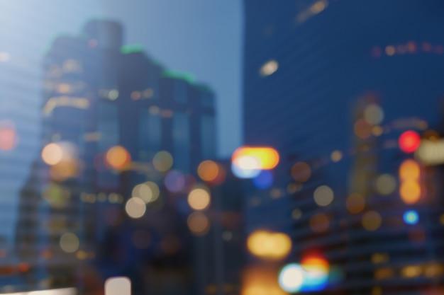 A cidade da noite ilumina o fundo do bokeh, luzes borradas que constroem o bokeh colorido da noite da cidade Foto Premium