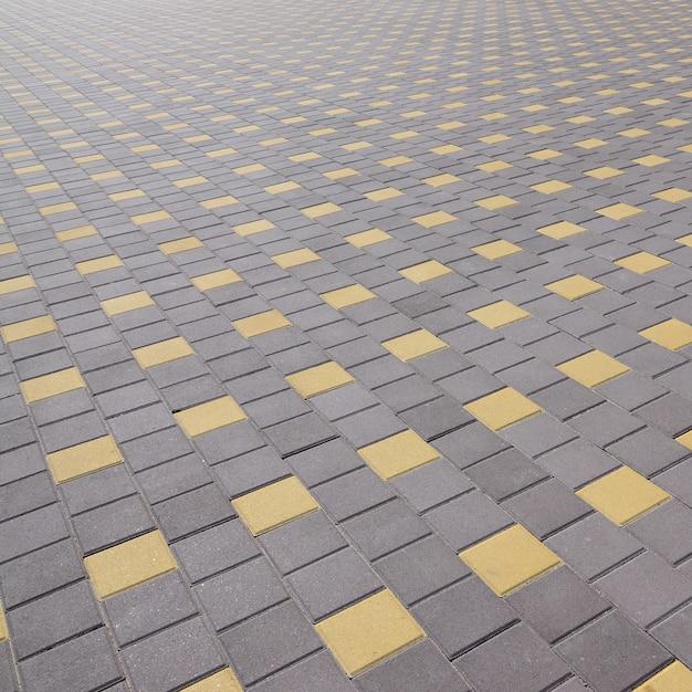 A estrada de paralelepípedos na praça da cidade. textura em perspectiva Foto Premium