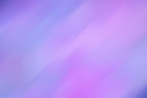 A imagem de bstract brilha cores diferentes azuis a cor-de-rosa ao lilás. fundo desfocado. ultramarino combinado com luz neon. estilo retro dos anos 80 Foto Premium