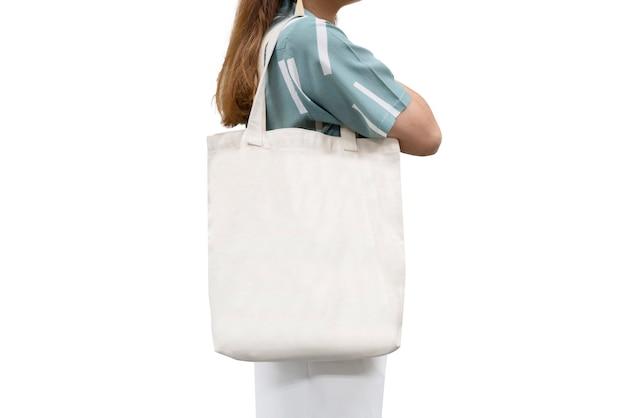 A mulher isolada levou a sacola branca da lona Foto Premium