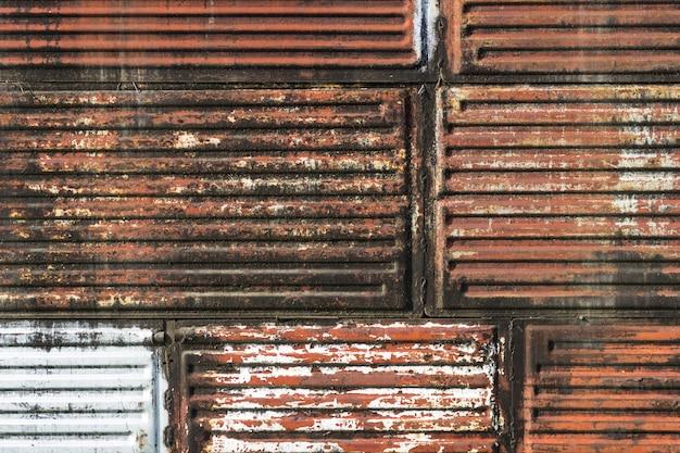 A textura do ferro velho é vermelha e marrom. plano de fundo para o texto. Foto Premium