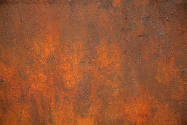 A textura do metal enferrujado é marrom e laranja. Foto Premium