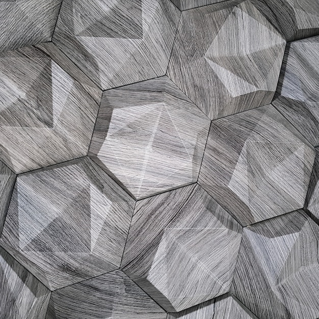 A textura dos ladrilhos cerâmicos na forma de um hexágono feito de pedra natural de cor cinza com superfícies convexas de fundo triangular Foto Premium