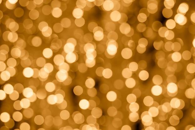 Abstrato dourado com luzes bokeh. planos de fundo iluminados. efeito embaçado. Foto Premium