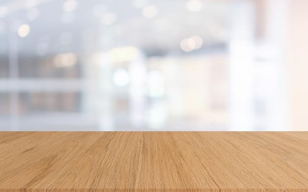 Abstrato turva fundo de lobby do hotel de luxo com mesa de madeira para mostrar, promover em exposição Foto Premium