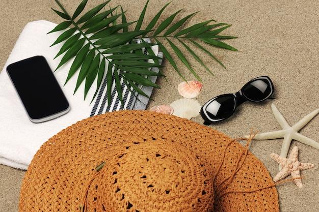 Acessórios de férias na praia Foto Premium