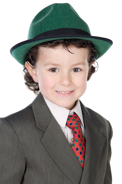 Adorável criança com roupas elegantes um fundo branco Foto Premium