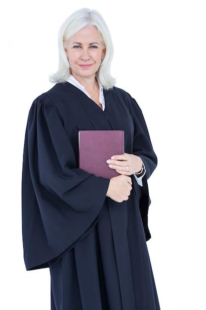 Advogado feliz olhando para a câmera e segurando o código de direito Foto Premium