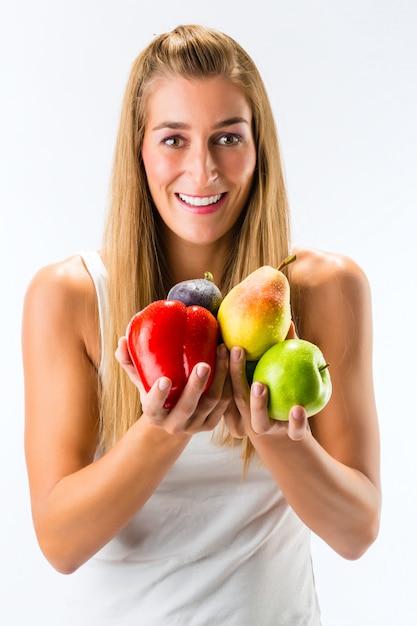Alimentação saudável, mulher com frutas e legumes Foto Premium