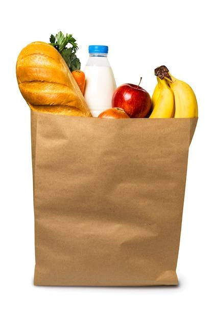 Alimentos em saco de papel em branco, isolado. Foto Premium