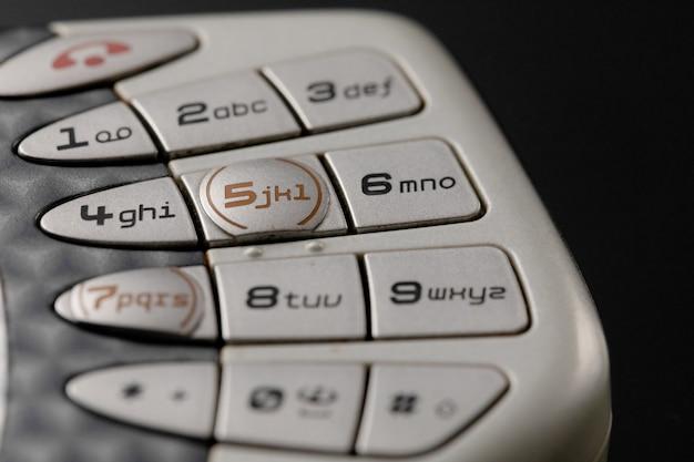 Almofadas de telefone celular. botões de close-up de telefone antigo Foto Premium