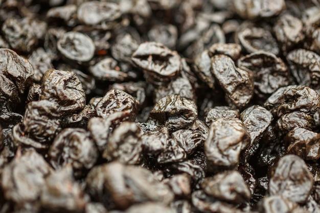 Ameixas secas, ameixas secas, frutos saudáveis. Foto Premium