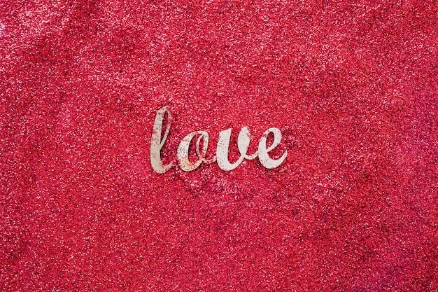 Amo escrever sobre glitter vermelho Foto gratuita