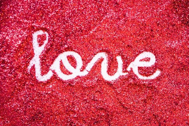 Amor escrevendo em glitter brilhante Foto gratuita