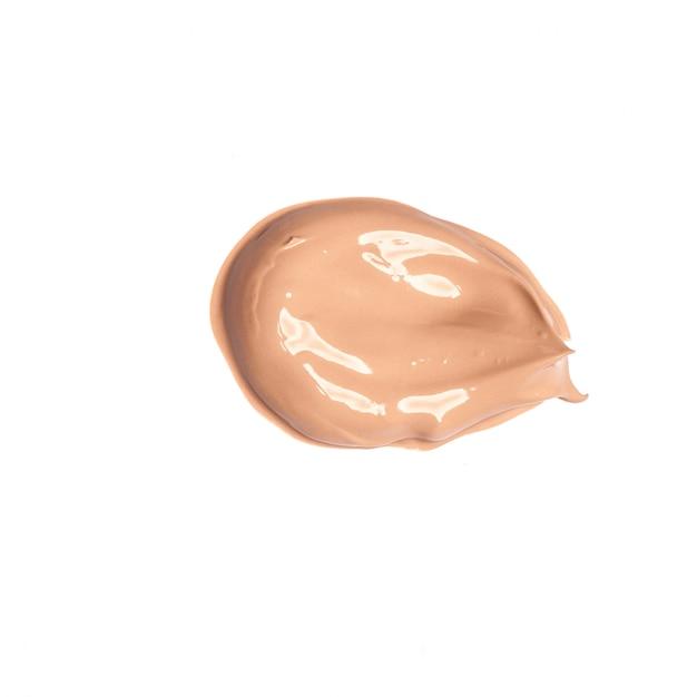 Amostra de cor de fundação manchada em branco Foto Premium