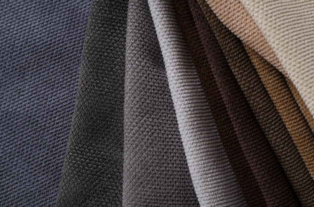 Amostras têxteis de veludo nas cores marrom, bege e cinza. textura de tecido Foto Premium