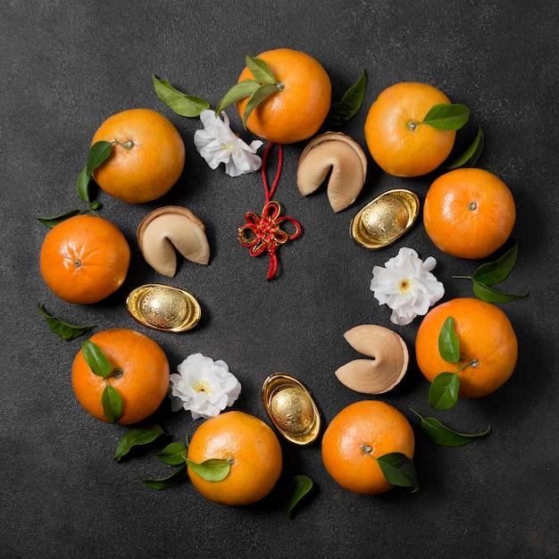Ano novo chinês com mandarinas Foto gratuita