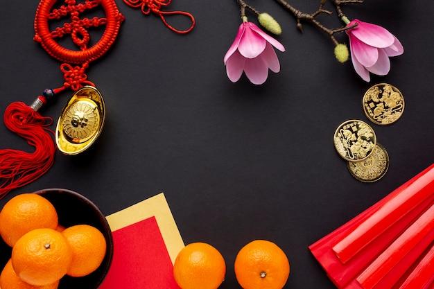 Ano novo chinês de magnólia e tangerinas Foto gratuita