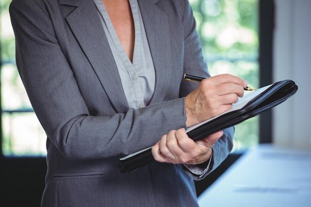 Anotações de empresária Foto Premium