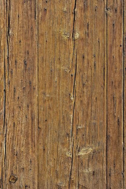 Antigo fundo de placa de madeira desbotada rachado vertical Foto gratuita