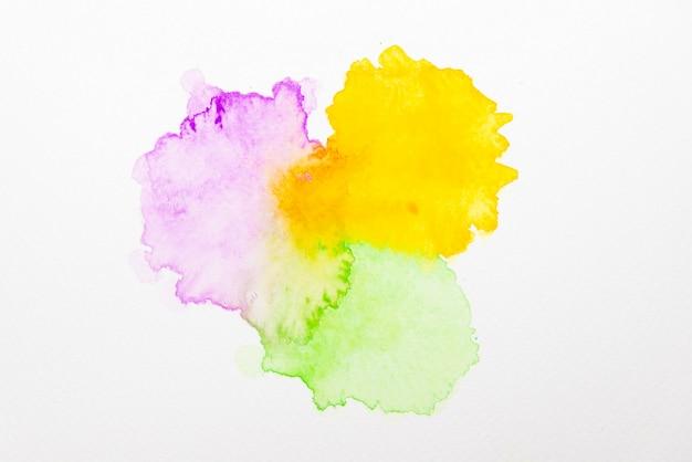 Aquarela abstrata violeta, amarela e verde sobre papel Foto Premium