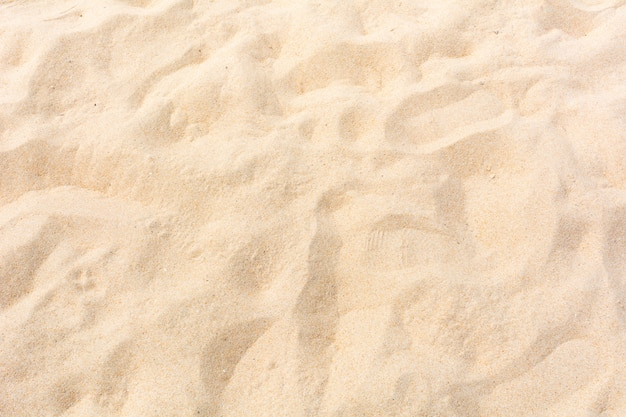 Areia natureza na praia como pano de fundo Foto Premium