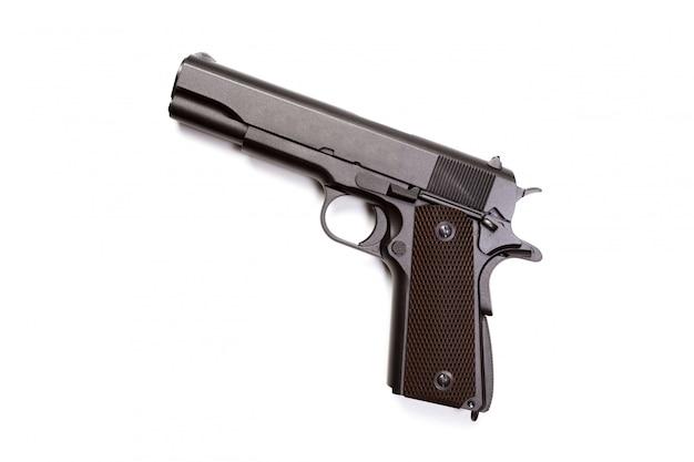 Arma de mão isolada no fundo branco Foto Premium