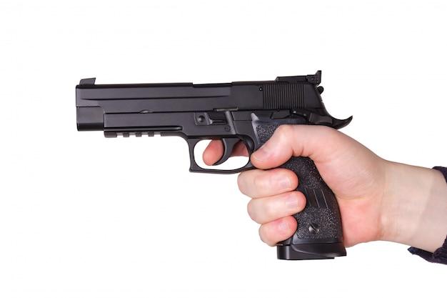 Arma na mão Foto Premium