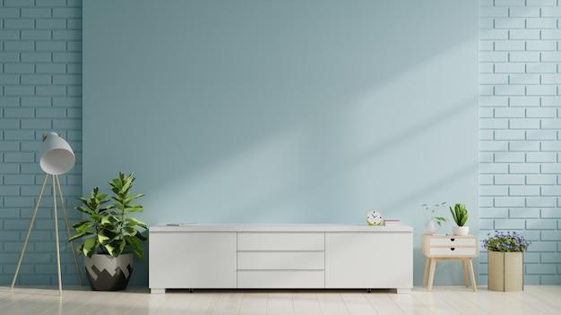 Armário de tv na moderna sala vazia na parede azul Foto Premium