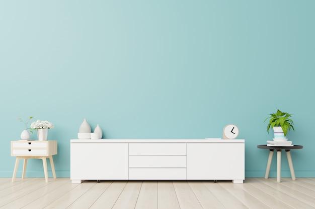 Armários para tv em uma sala, paredes azuis Foto Premium