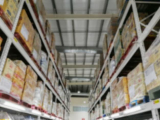 Armazém de armazenamento de mercadorias em armazéns, imagens borradas Foto Premium