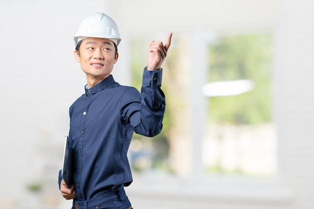 Arquiteto asiático jovem bonito Foto Premium