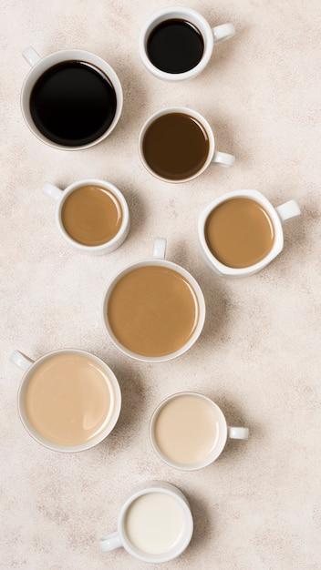 Arranjo de vista superior de deliciosos tipos de café com gradiente Foto gratuita
