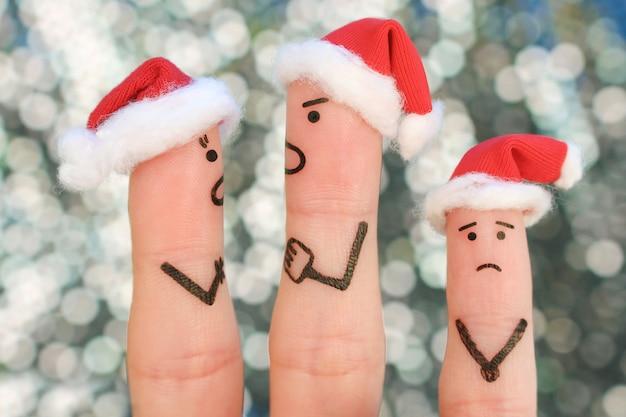 Arte de dedos do casal comemora o natal. conceito de homem e mulher durante briga no ano novo, criança está chateada. Foto Premium