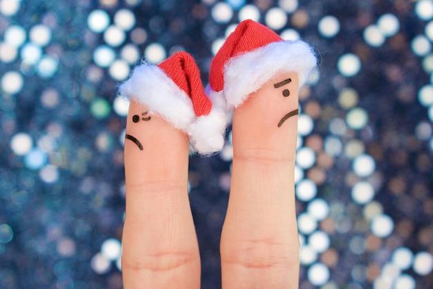 Arte de dedos do casal comemora o natal. conceito de homem e mulher durante briga no ano novo. Foto Premium
