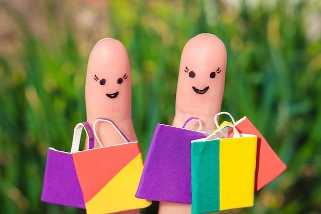 Arte do dedo de um feliz amigos com sacos de compras Foto Premium