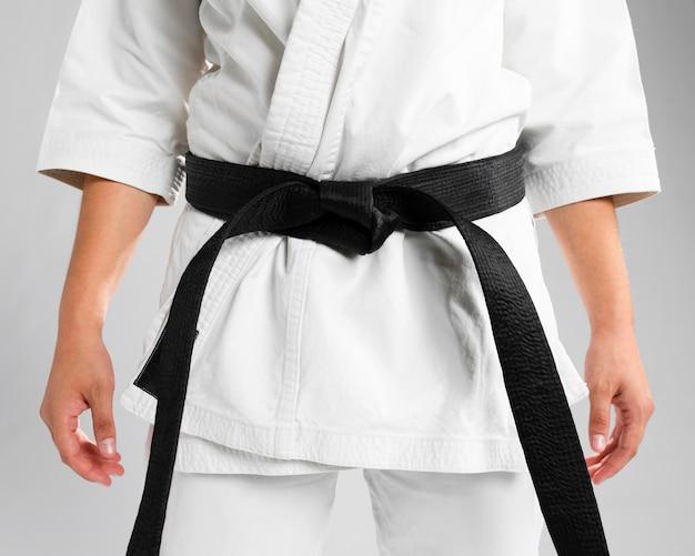 Artes marciais de close-up de faixa preta Foto gratuita