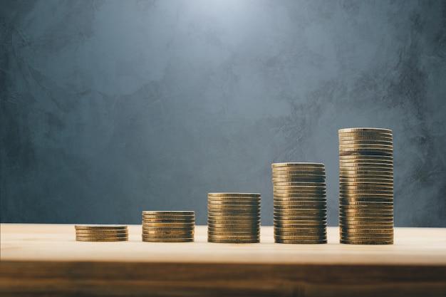 As fileiras das moedas financiam e depositam o conceito do fundo. Foto Premium