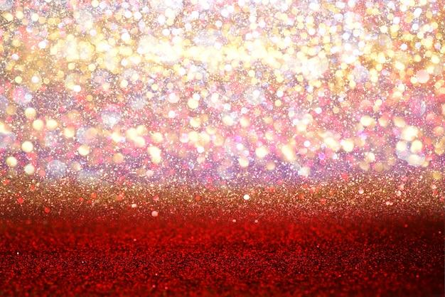 As luzes vermelhas do vintage do brilho texture o fundo abstrato do bokeh. desfocado Foto Premium