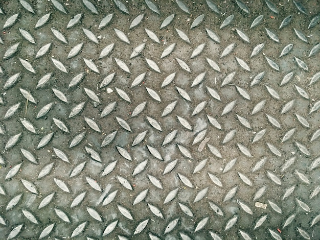 Assoalho de aço do fundo abstrato do teste padrão na fábrica industrial Foto Premium